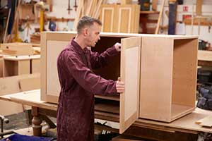 carpenter using mdo plywood to build cabinets