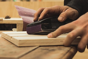 person working on one of the 9 different types of plywood