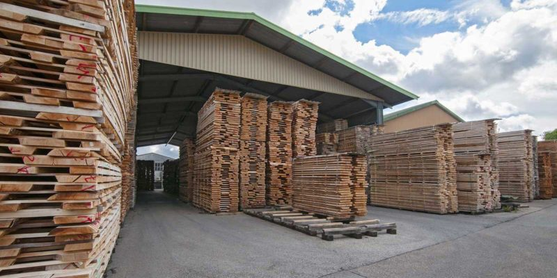 stacks of lumber at a wholesale lumber yard