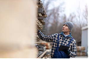 Lumber supplier taking inventory of wood