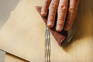 Hand sanding plywood