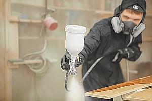Man spraying wood