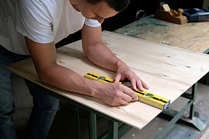 Man working with plywood