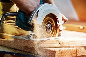 Saw cutting into wood