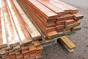 Stacks of treated wood planks