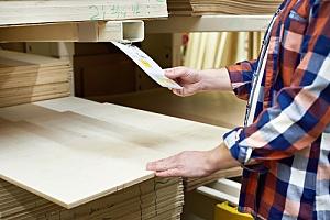 Man checking plywood price