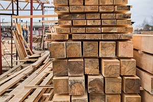 Stacked pile of lumber in storage
