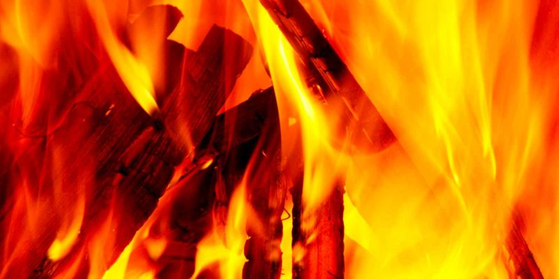a-close-up-view-of-combustible-plywood-on-fire