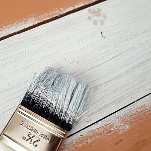 white paint on southern yellow pine with paintbrush