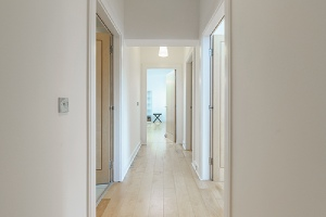 Bright hallway in an apartment.Many use fire-retardant wood for corridors and hallways construction.