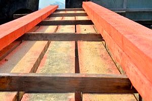 a row of fire-retardant wood at a construction site that can be used on a roof or doorway