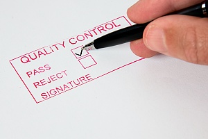 person filling out a quality control form for fire-retardant plywood