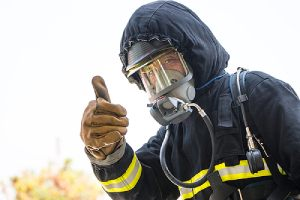 A fireman giving thumb up. Fire retardant plywood is not the same as fire retardant wood