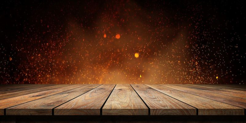 Fire retardant plywood planks with flame effect on dark background