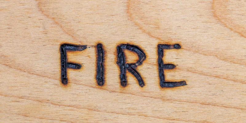 Word fire etched on the surface of fire retardant plywood
