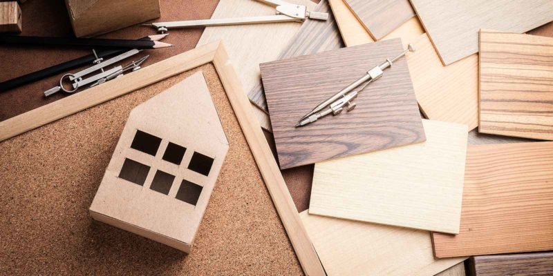 Fire-rated plywood samples and a replica of miniature house