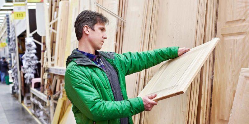 Man shopping Pyro Guard plywood