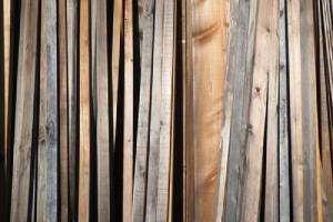 Stack of weathered planks. The main benefit of copper azole treatment is that it extends the longevity of the lumber