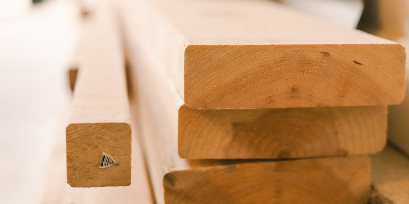 Lumbers on a construction site. Wholesale lumber suppliers offer a broader range of lumber options