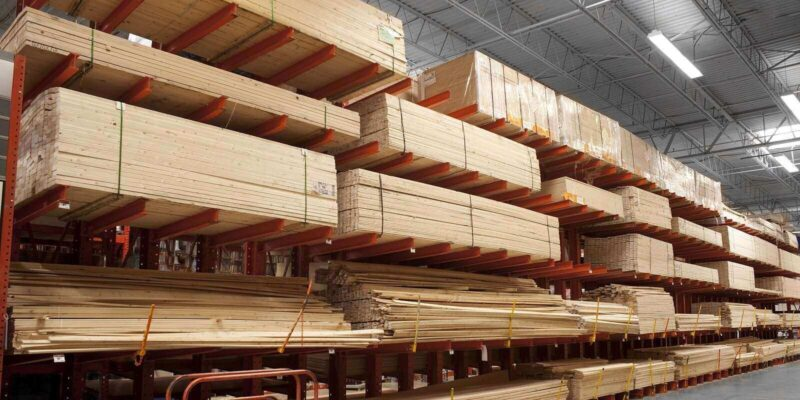 Wholesale Lumber Supplier-Wood Stacked on Shelving Inside a Lumber Yard