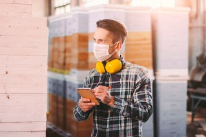 man-supervisor-inspecting-warehouse-during-covid19-quarantine-picture