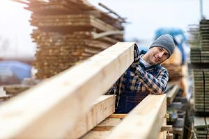 A worker helping customer pick the right green building materials
