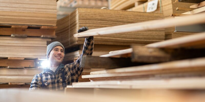 A worker in green building materials warehouse