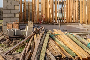 Wholesale Lumber Supplier and concrete blocks by single-family house under construction