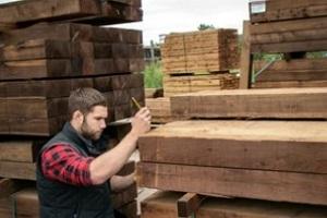 storeman checking lumber quality